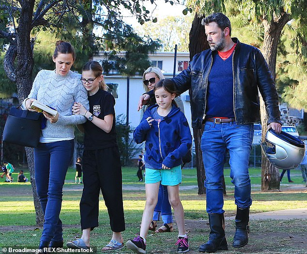 The whole gang: In addition to Samuel, the amicable co-parents share Violet, 14, and Seraphina, 11