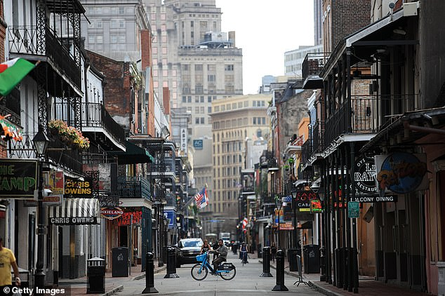 New Orleans (above during the lockdown) remains a national virus hotspot. The death toll in the city is now at 409. The city's Mardi Gras celebrations had been blamed for the causing the virus to spread so rapidly across the state but underlying health conditions are also to blame