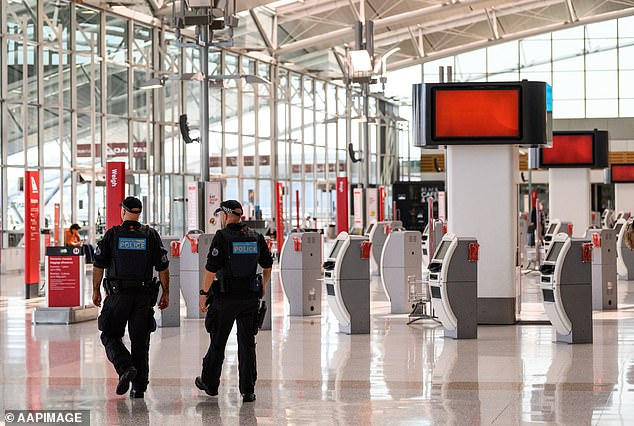 Police officers in the deserted Sydney domestic airport on March 20 amid the coronavirus pandemic