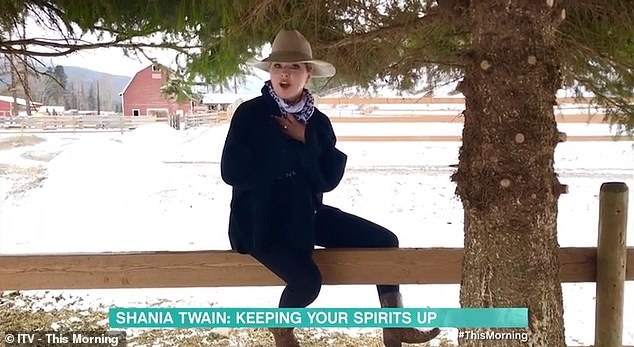 Gesture:The Country music legend, 54, revealed at the start of her performance that she had hoped her song would 'lift the spirits' and 'bring some cheer' to Britons amid the coronavirus pandemic