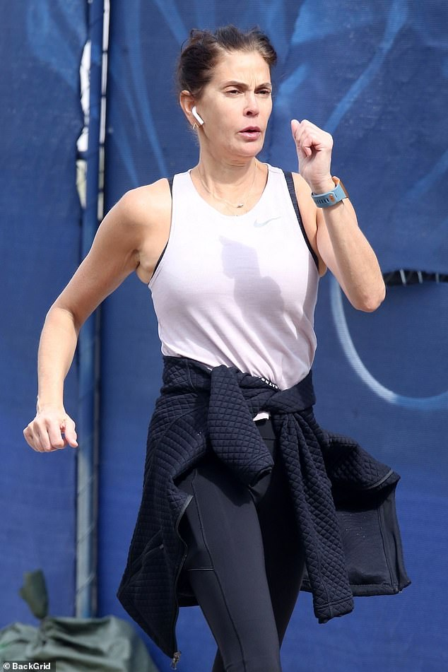 Staying Healthy: Teri Hatcher is pictured walking briskly in downtown Los Angeles on Sunday