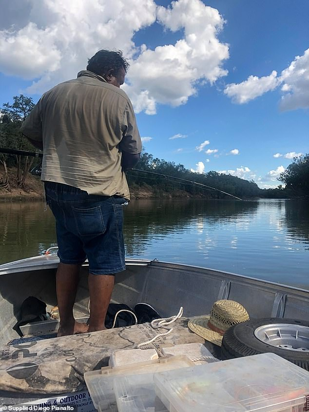 The father and son had gone on a fishing trip on the Norther Territory's Daly River when a crocodile knocked the engine off their boat