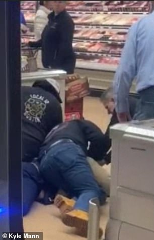 Shoppers tackle man who started coughing and SPITTING on food at Massachusetts grocery store