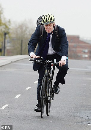 Boris Johnson is pictured cycling in 2015