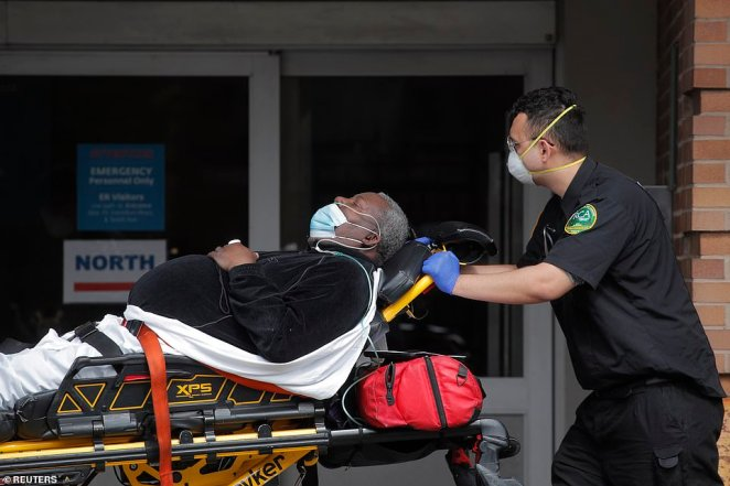 Paramedics take a patient into emergency center at Maimonides Medical Center during the outbreak of the coronavirus disease