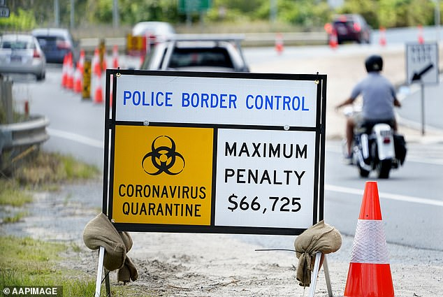 Australia has strict border controls with heavy penalties. Motorists are pictured crossing a level crossing between New South Wales and Queensland on April 2