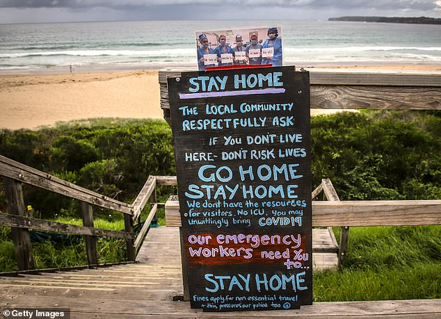A hand-painted sign at Mollymook on the NSW South Coast on Wednesday