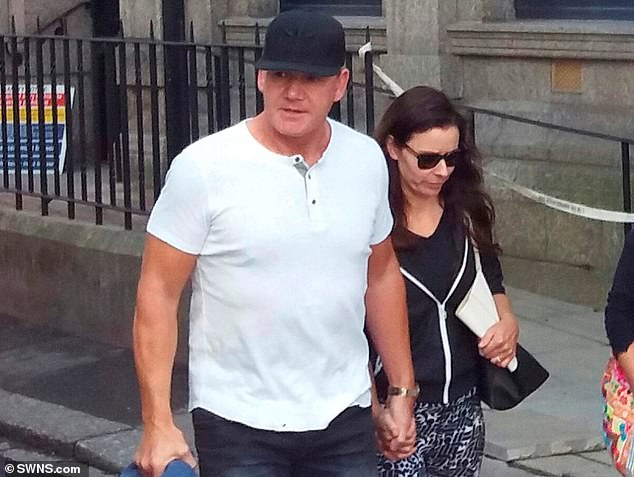 Gordon Ramsay and his wife, Tana, walk past the old Lloyds Bank building in Fowey, Cornwall, which has been bought by the chef. Lloyds closed branch in 2015
