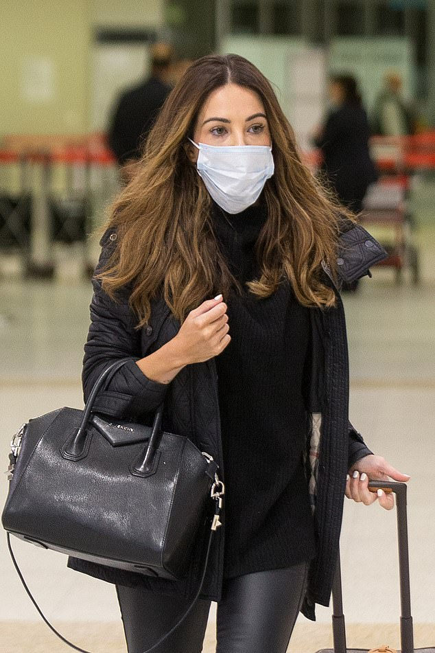 That looks a little loose! Married At First Sight's KC Osborne may need a refresher course on how to properly wear a face mask during the COVID-19 pandemic