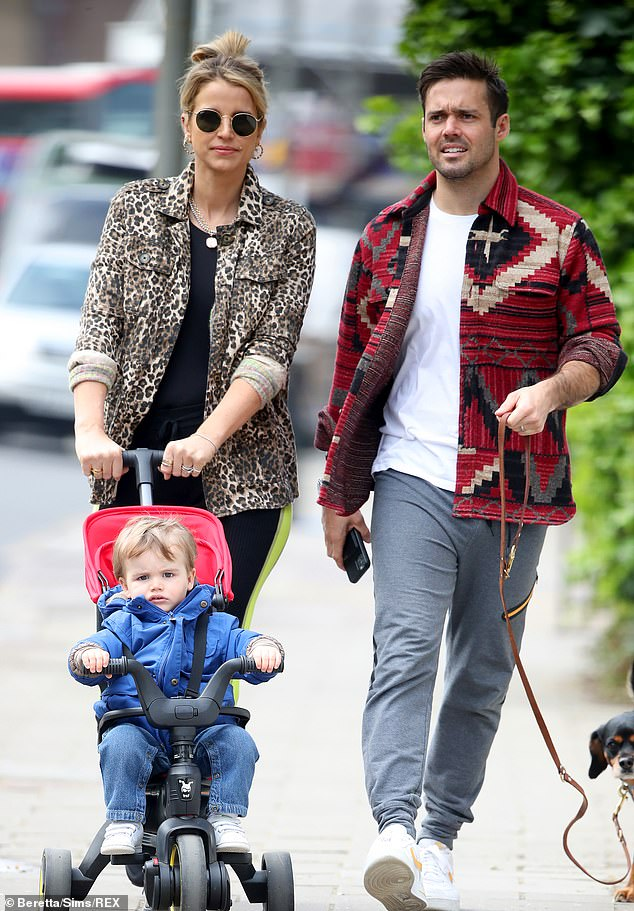 Family fun: Pregnant Vogue Williams enjoyed a stroll with Spencer Matthews and their son Theodore on Wednesday (and pet dog Winston came along, too!)