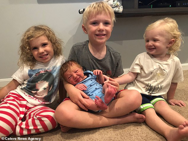 Brittany's unconventional birth of Nash led to her decision of having an unassisted home birth with her fourth child Crew, seven months. Pictured, Ella, five, Jett, six, holding Nash, now three, and Crew, seven months
