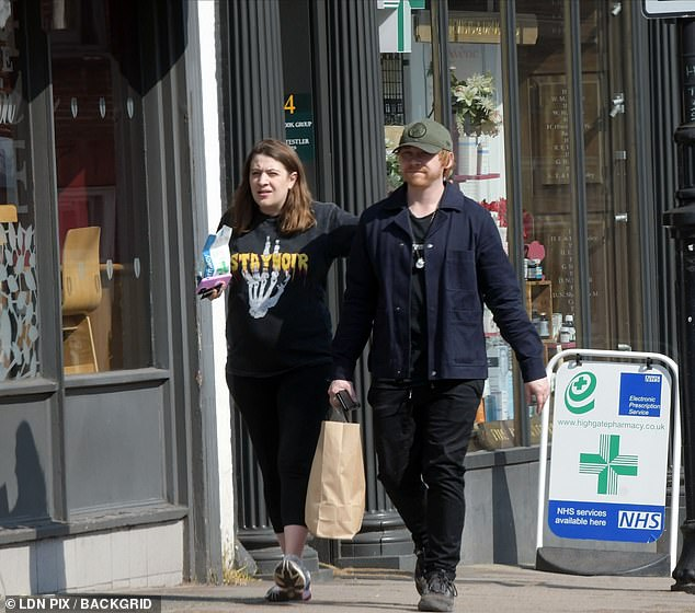 Supply: the happy couple was photographed walking in the sun after visiting a pharmacy and a Wholefoods to pick up groceries