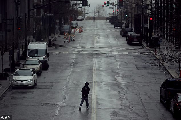 Wired conducted the poll that found nearly 15 percent are confused about the policy in their area, with a majority of misinformed living Missouri (pictured is an empty street in downtown Kansas City)The state reported being the most confused, as it just implemented a stay-at-home policy on Monday