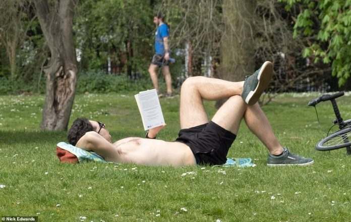 Bathers begin to gather on the grass at Battersea Park, including this relaxing drive which stopped after riding its bike at London Park on Sunday morning. NHS nurses and doctors repeatedly begged the public to stay indoors, except when absolutely necessary.