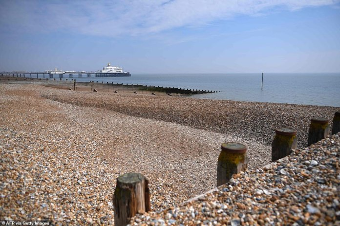 Eastbourne Beach on the South Coast is deserted this morning (Sunday) as the British listen to advice to stay inside and stop the spread of Covid-19