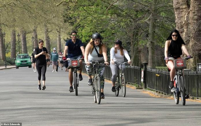People have been told not to cycle with friends, if you are doing it for group exercise, it should only be with people in the same household. The public has also been advised to stay two meters apart, as this group appears to be trying to do at Battersea Park on Sunday.