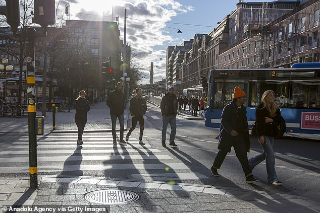 People hang out on the street in central Stockholm amid the new coronavirus pandemic in Stockholm, Sweden