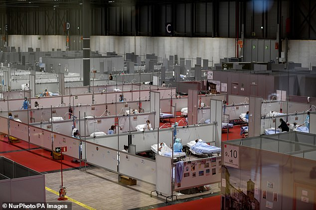 Many countries have set up makeshift hospitals to deal with the crisis, including here at a convention centre in Madrid