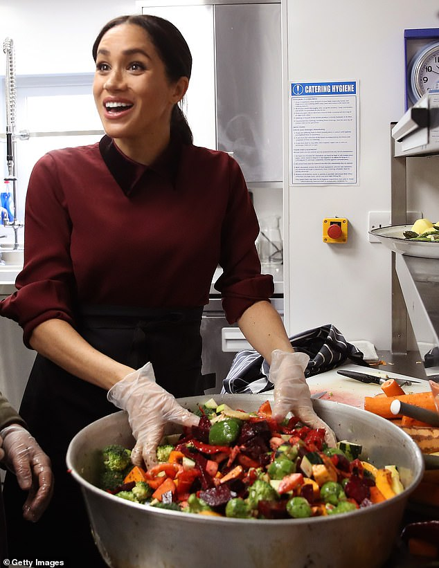 The couple volunteered with the local Angel Food charity project on Easter Sunday and returned Wednesday to drop off non-perishable meals for 20 more vulnerable people in the city. In the photo, Meghan at the Hubb community kitchen in London in November 2018
