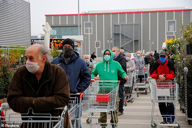 Customers push trolleys outside a hardware store in Eisenstadt on Tuesday, after the Austrian government allowed some shops to re-open with a view to opening others on May 1