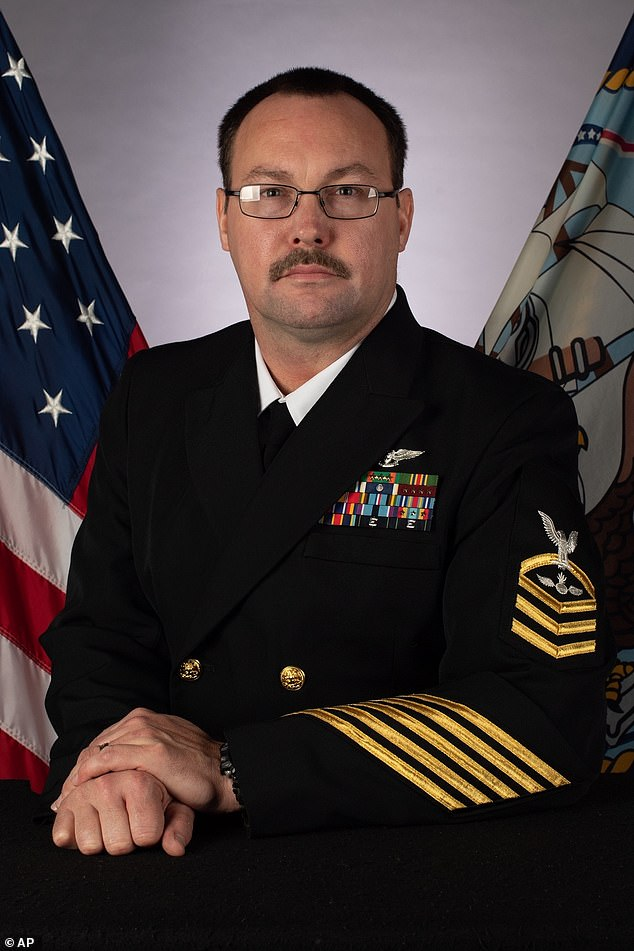 A photo provided by the US Navy shows Chief Petty Officer Charles Robert Thacker Jr., 41, of Fort Smith, Arkansas, assigned to the USS Theodore Roosevelt, who died from the coronavirus on Monday at US Naval Hospital Guam