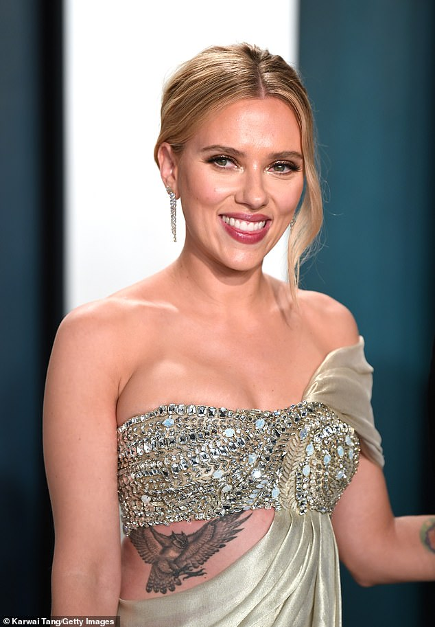 Over a girl:While the actor struggled to remember the specifics, he said it did start over Ryan's ex-wife, Scarlett Johansson (pictured) who he was married to from 2008 until 2011
