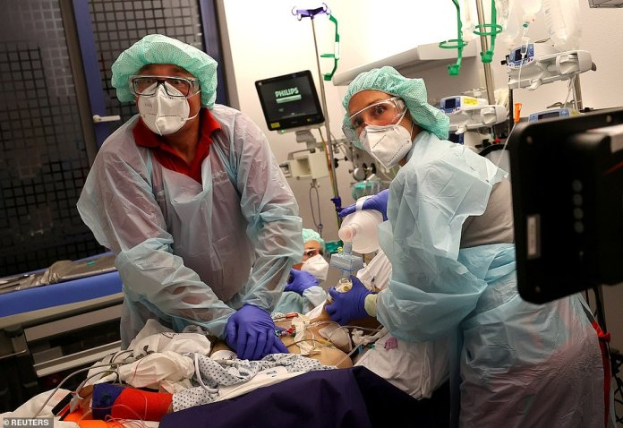Doctor Katharina Franz and paramedic Andreas Hankel attempt to resuscitate a coronavirus patient at a clinic in Hanau, Germany
