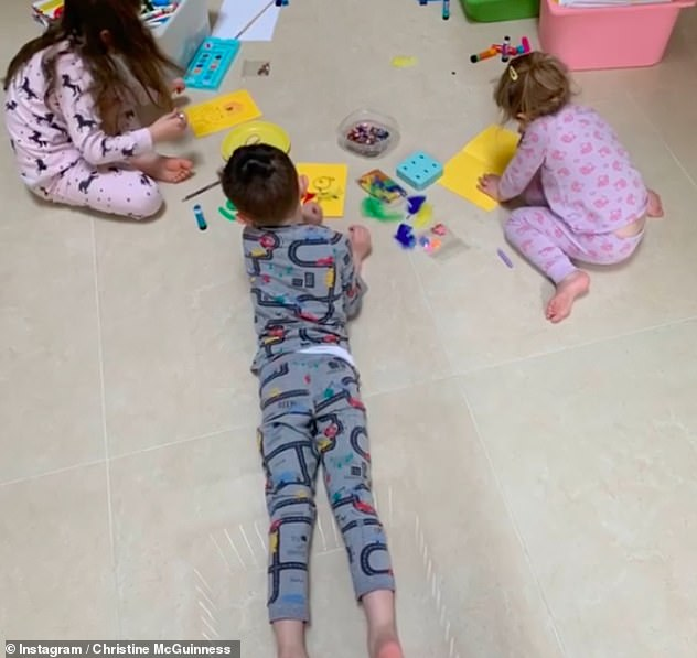In good company: she was locked up at home with her husband Paddy and their children Leo and Penelope, 6, and Felicity, 4 (photo)