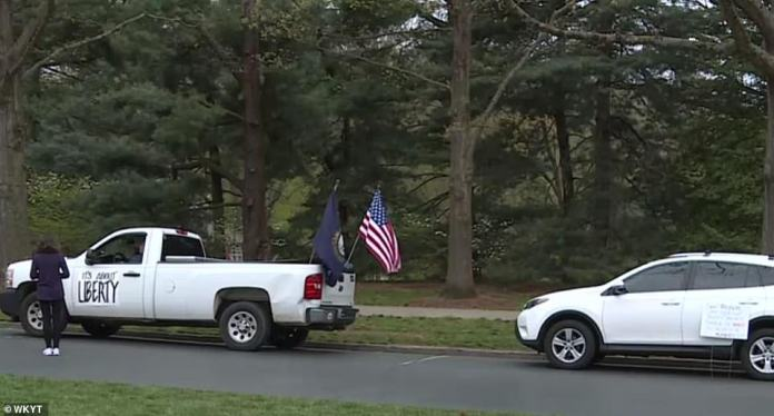 Another motorist who took part in the protest attached a sign to their vehicle which read 'It's about liberty' in Frankfort on Friday