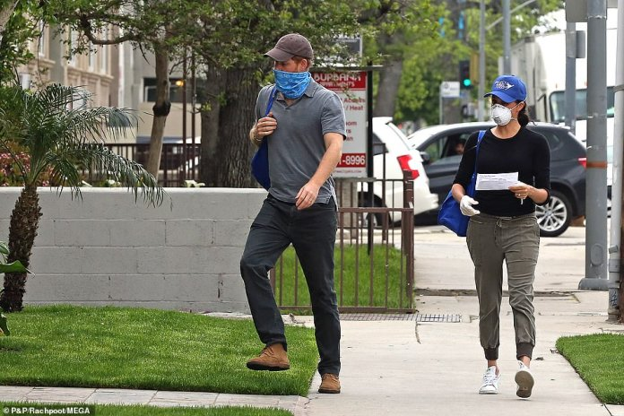 Meghan Markle and Prince Harry were again spotted on the streets of Los Angeles as they continued their charitable volunteer work amid the coronavirus crisis