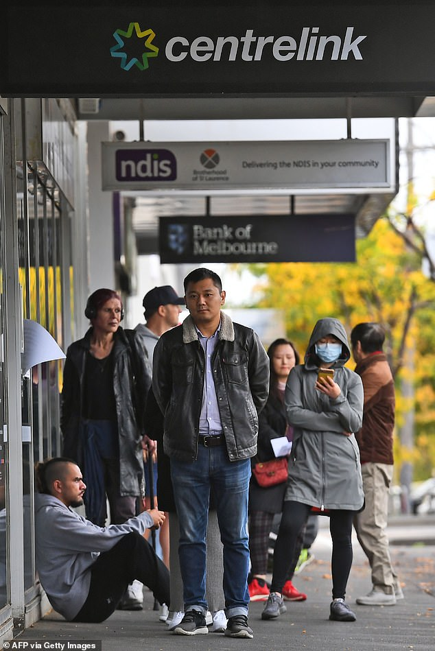 A report from the Grattan Institute predicts between 14 and 26 per cent of Australian workers could be out of work as a direct result of the coronavirus shutdown. Pictured: People queuing up outside a Centrelink office in Melbourne on April 20, 2020,