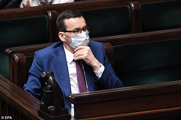 Polish Prime Minister Mateusz Morawieck (pictured in a parliamentary debate on April 16) said companies must pay national business taxes before they can claim one of the country's £ 5 billion bailout package.