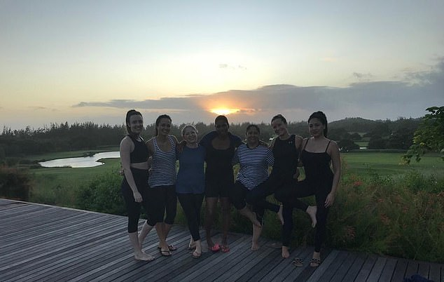 A group being taught about the healing properties of essential oils before trying sunset yoga in Mauritius