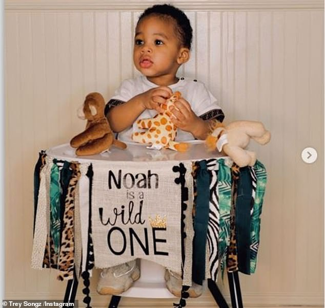 Noah Wild: The final photo was a solo photo of Noah, sitting on a high chair playing with some of his toys, with a cloth that said, `` Noah is a Wild ''