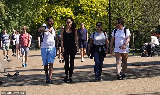 People enjoying the sun and warm weather at Potters Fields Park, next to Tower Bridge in London, Wednesday