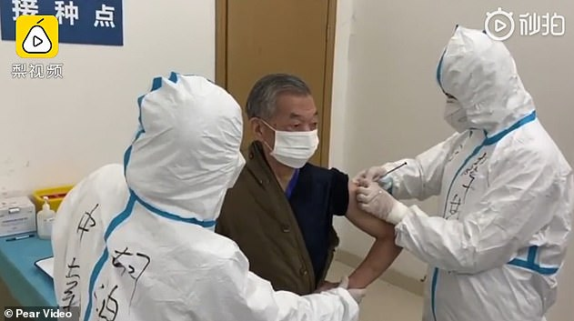 An 84-year-old retired soldier, Xiong Zhengxing, is believed to be the world's oldest volunteer for a potential coronavirus vaccine. He is pictured receiving the injection