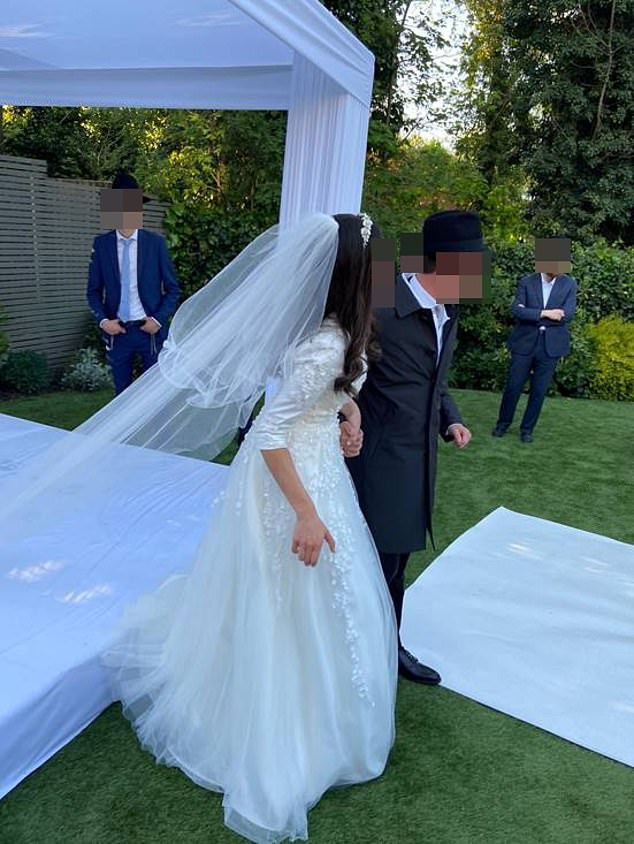 Bride and groom just after traditional wedding ceremony in North London garden
