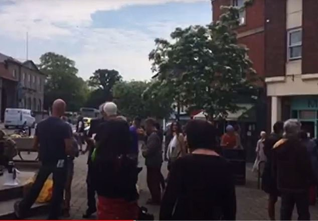 Filmed footage of activists at Glastonbury Market Place shows them in conflict with police - and denying that social distancing is necessary to stop the spread of the disease