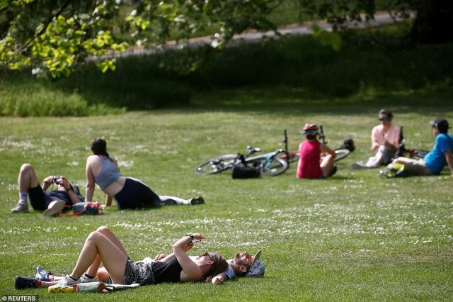 People were also seen sunbathing in St James's Park amid unseasonably warm weather