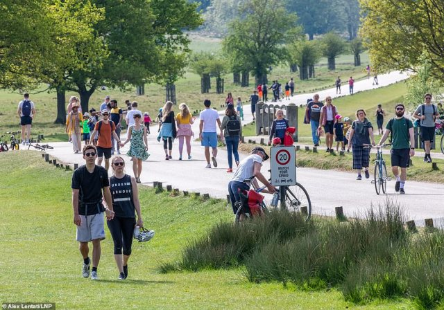 Members of the public go out to enjoy the warm weather in Richmond Park, London today, with the park looking extremely busy