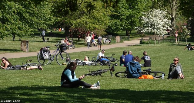 Londoners also enjoyed the sun in Green Park, where they sat on the grass next to bicycles
