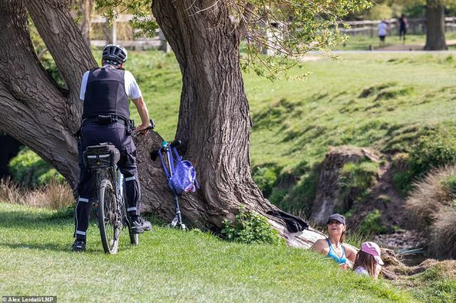 In Richmond Park, a police officer on a bicycle spoke to a mother and daughter as they sat under a tree, despite orders from the Government for people to only use parks for exercise once a day