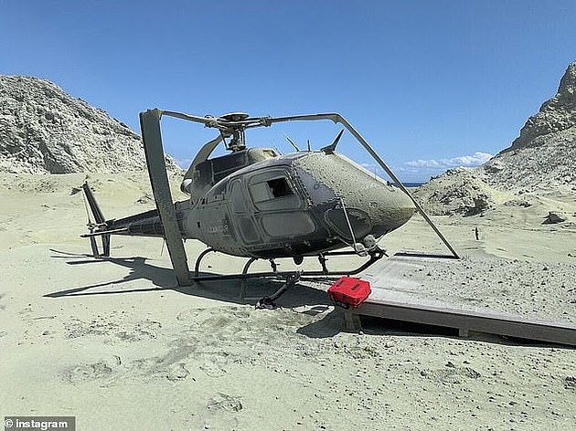 A tour helicopter which had its rotors destroyed during White Island volcano eruption in New Zealand on December 9