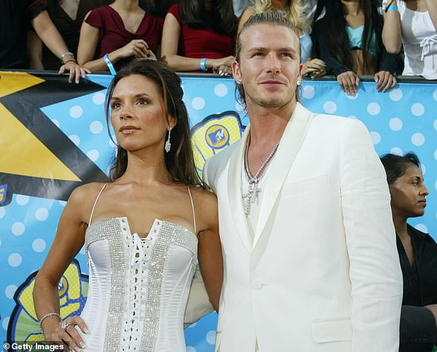Beckham poses for photo with wife Victoria at 2003 MTV Movie Awards