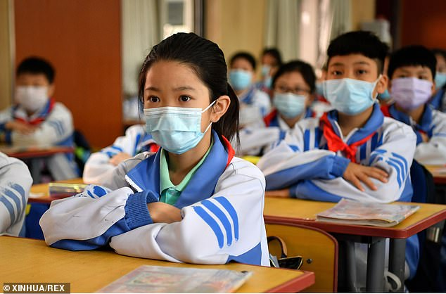 The death toll in China stands at 4,633, according to the latest government report.Students are pictured attending a class while wearing masks in the Chinese city of Xi'an on Monday