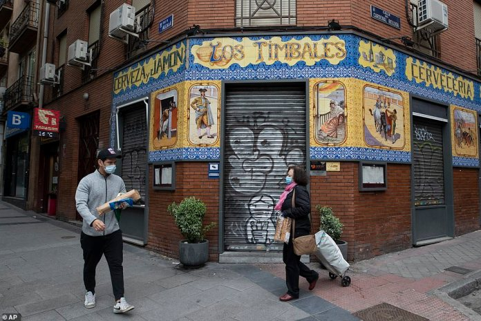 Spain to present plans to end foreclosure today, including when bars (pictured in Madrid) and restaurants may reopen