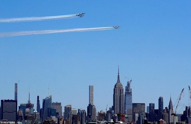 Navy Blue Angels and Air Force Thunderbirds demonstration teams participate in flyover over the Empire State building