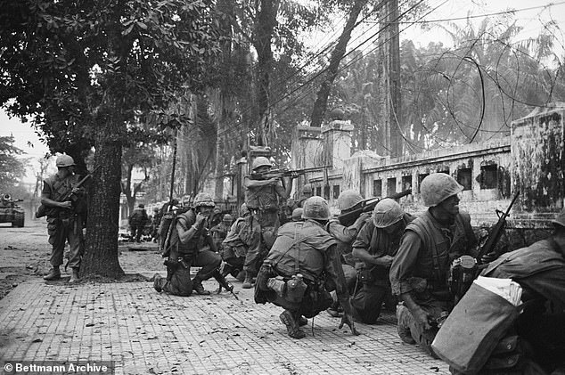 U.S. Marines keeping low because of intense sniper fire battle in Vietnam in 1968. This was the most deadly year of the Vietnam War when16,899 U.S. personnel died. In comparison, coronavirus death across America have been greater than this over the past ten days alone