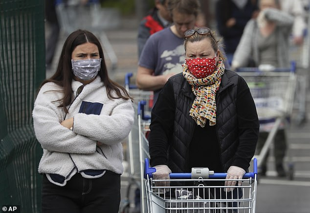So far London has had 4,781 deaths since the outbreak began, killing 0.053 per cent of its 9million population. People queuing for a supermarket wearing masks in London today