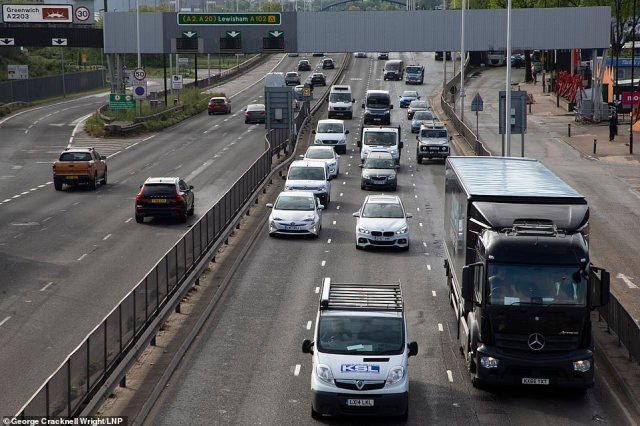 Traffic builds up on the A102 in Greenwich south east London on Wednesday as the UK's lockdown traffic peaked today